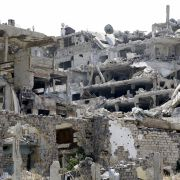 This Aug. 14, 2016, picture shows heavily damaged buildings in the al-Khalediah neighborhood of the central Syrian city of Homs.