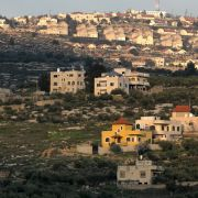 This picture taken on Feb. 22, 2020, shows the Palestinian West Bank village of Azmut, east of Nablus, with the Israeli settlement of Elon Moreh in the background.