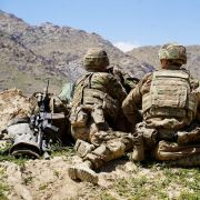U.S. soldiers look out over the hillsides of an Afghan army checkpoint in Afghanistan's Wardak province on June 6, 2019.