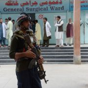 An Afghan police officer stands guard after a political rally was attacked in Nangarhar province in early October.