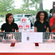 Employees introduce cellphones during a show by Chinese tech firm Huawei in Lusaka, Zambia, during April 2016.