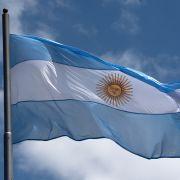 The national flag of Argentina flies above Avenida 9 de Julio, one of the major arteries of Buenos Aires, on Nov. 28, 2018.