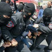 In this photograph, Armenian police arrest a man during a protest in Yerevan, the country's capital, on April 22, 2018.