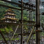 A Buddhist temple sits near a hydroelectric grid main in southeastern Bhutan in 2013.