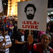"A demonstrator holding a ""Free Lula"" sign shows his support for former Brazilian President Luiz Inacio Lula da Silva during a May 30, 2018, protest in Sao Paulo. Da Silva was imprisoned in April on a corruption conviction."