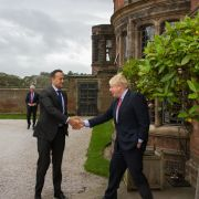 British Prime Minister Boris Johnson, right, greets his Irish counterpart, Leo Varadkar, on Oct. 10, 2019, in Liverpool, England.