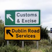 Signs point to an old customs and excise area in Newry, Northern Ireland, on Oct. 1, 2019 on the border between Newry in Northern Ireland and Dundalk in the Irish Republic.