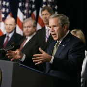 In this 2005 file photo, former U.S. President George W. Bush talks about the Central America-Dominican Republic Free Trade Agreement in Washington, joined by former Cabinet officials who supported the trade deal.