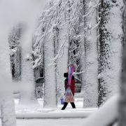 Snow covers a street in Bishkek, the capital of Kyrgyzstan, on Dec. 27, 2017.