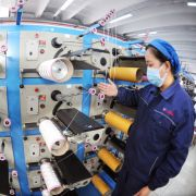 Workers operate a production line of a new material company in Lianyungang, China, on March 23, 2020.