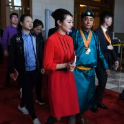 Guests leave a ceremony marking the 100th anniversary of China's May Fourth Movement against Western imperialism on April 30, 2019, in Beijing's Great Hall of the People.