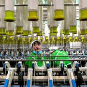 An employee works in a textile factory in Xiayi county in Shangqiu in China's central Henan province.