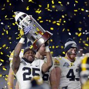 Originating with a few New Year's Day contests, college football bowl games have evolved into a commercialized spectacle spread out over almost a month of competition.