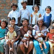 An Indian tribal couple poses with their 11 children in the Nalgonda district. For most of human history, high total fertility rates have been preconditions of national greatness, while low ones have been strategic suicide.