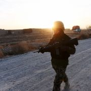 An Afghan soldier on patrol in southern Afghanistan, Dec. 11, 2014.
