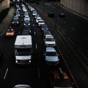 This image shows vehicles traveling through Brooklyn. The White House will decide soon whether to claim the power to impose tariffs on auto imports it deems unfair.