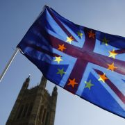 An activist waves a combination of the Union Jack and EU flags near the British Houses of Parliament in London on April 10, 2019.