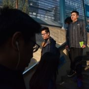 People walk into a subway station in Beijing on Oct. 19, 2018.