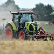 A farmer drives a tractor as he sows his field in a field near Bouloire north-western France on Aug. 21, 2018.