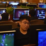 This photo shows gamers at an internet bar in Beijing. China's tight control of its citizens is mirrored in its locked-down internet.