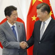 Japanese Prime Minister Shinzo Abe shakes hands with Chinese President Xi Jinping before a bilateral meeting in Russia during the 2018 Eastern Economic Forum.