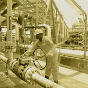 A worker inspects a Total oil drilling platform near Port Harcourt in the Niger Delta.