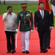 Chinese President Xi Jinping, right, and Philippine President Rodrigo Duterte, left, inspect the troops during a welcoming ceremony at the Malacanang Palace in Manila on Nov. 20, 2018.