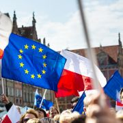 In this photograph, demonstrators carry Polish and European Union flags during a 2016 rally in Gdansk, Poland.