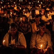 People hold candles during a ceremony commemorating the 25th anniversary of the Rwandan Genocide on April 7, 2019, at the Amahoro Stadium in Kigali.