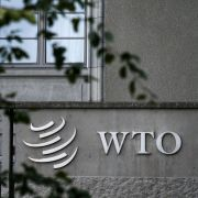 A sign of the World Trade Organization (WTO) is seen at the body's headquarters in Geneva on Sept. 21.