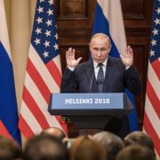 U.S. President Donald Trump (L) and Russian President Vladimir Putin answer questions about the 2016 U.S. Election collusion during a joint press conference after their summit on July 16, 2018, in Helsinki, Finland.