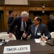 Timor-Leste's Foreign Affairs minister Jose Luis Gutierrez (R) speaks with Australian lawyer Bernard Collaery (L) during a session of the International Court of Justice in 2014. Collaery faces prosecution in Australia for disclosing information about the country's intelligence services in a case worthy of a spy novel.
