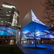 The historic facade of Frankfurt's Grossmarkthalle, now part of the building of the European Central Bank (ECB), is illuminated on March 16, 2018.