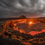 "Lava rises to the top inside Erta Ale volcano in the Afar region of northeastern Ethiopia. The Ethiopian volcano is home to the world's oldest continuously active lava lake, known as the ""Gateway To Hell."""