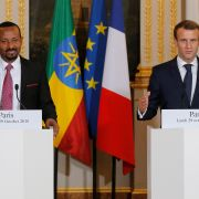 French President Emmanuel Macron gestures during a news conference with Ethiopian Prime Minister Abiy Ahmed in Paris on Oct. 29, 2018.