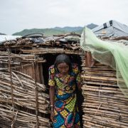A Fulani woman, forced into a camp for internally displaced persons by violence in northeastern Nigeria, emerges from her temporary dwelling.