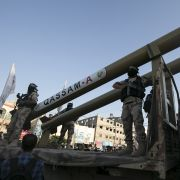 Palestinians from the armed wing of the Hamas movement, display Qassam home-made rockets during an anti-Israel military parade in Rafah in the southern Gaza Strip, Aug. 21, 2016.