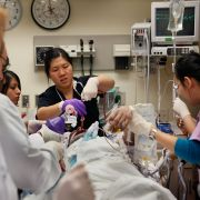 Doctors and nurses in a Chicago hospital's trauma unit work to revive a man hit by a car.