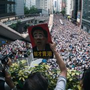 People in Hong Kong join a mass protest against the government's controversial extradition law on June 9, 2019.
