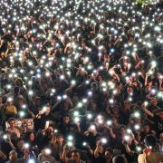 Protesters hold up their lighted phones during a July 5, 2019, rally in Hong Kong.