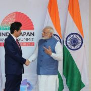 Indian Prime Minister Narendra Modi (right) shakes hand with Japanese Prime Minister Shinzo Abe during the annual India-Japan summit on Sept. 14, 2017. Behind the two world leaders are their countries' respective flags.