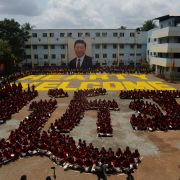 Indian students form the Chinese character for the name of Chinese President Xi Jinping, in Chennai on Oct. 10, 2019, ahead of a summit between Xi and his Indian counterpart, Narendra Modi.
