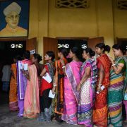Indian voters stand in line to cast their votes.