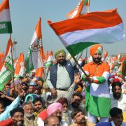 Supporters hold up flags in support of the Indian National Congress (INC) party during the launch of the party's campaign in Punjab ahead of India's upcoming  elections.