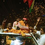 Samajwadi Party candidate Nagendra Pratap Singh Patel, center, celebrates with supporters in Allahabad after winning election to India's lower house of Parliament on March 14, 2018.