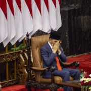 "Indonesian President Joko ""Jokowi"" Widodo prays during his inauguration for his second term on Oct. 20, 2019, in Jakarta."