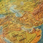A vintage map shows the Middle East, including Iran.