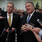 U.S. Secretary of State Mike Pompeo, right, and Acting Defense Secretary Patrick Shanahan talk with reporters after briefing members of Congress about Iran on May 21, 2019.