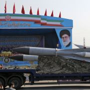 An Iranian military truck carries surface-to-air missiles past a portrait of Iran's Supreme Leader Ayatollah Ali Khamenei during a military parade in Tehran.