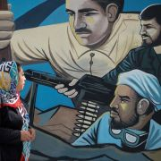 A street mural in Tehran depicts Iranian soldiers in action.